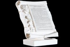 Classical white marble Hippocratic Oath isolated on black background Stock Photos
