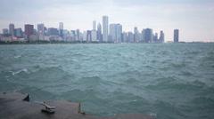 Splashing crashing waves of Lake Michigan slow motion Chicago skyline Stock Footage