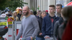 Young and old people walking on the street in Berlin Stock Footage