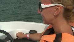 Blond girl extremely pilot speed motor boat Stock Footage