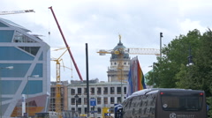 Cranes and flags near the French Cathedral in Berlin Stock Footage