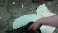 Wallpaper stripping disposing of stripped paper. - stock footage