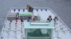 White sightseeing boat floating on Spree River, Berlin Stock Footage
