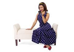Black Pinup Girl in Polka Dot Dress Stock Photos