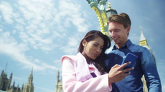 4K Attractive mixed ethnicity couple with mobile phone in London Stock Footage