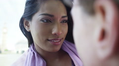 4K Close up of romantic mixed ethnicity couple looking into each other's eyes Stock Footage