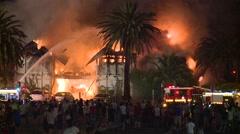 Crowd watch massive inferno Stock Footage