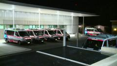 Hospital Emergency Department with EMS vehicles Stock Footage