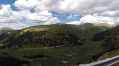 Driving along a high mountain road in Colorado looking at the valley below. - stock footage