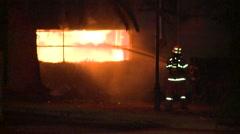 Fire Fighting through window Stock Footage