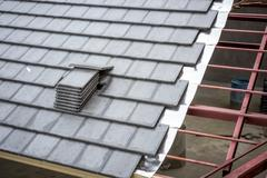 The newly designed roof tiles - stock photo