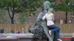 Taking pictures with the statue of Neptune Fountain in Berlin Stock Footage