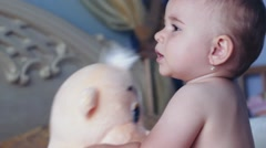 A child playing with soft toys . Stock Footage