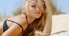 Beautiful Girl in Bikini Posing on Beach - stock footage