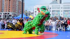 China symbol dancing during Sports exhibition 2014, Kiev, Ukraine. Stock Footage