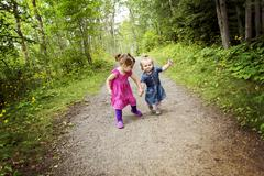 Cute little sisters having fun on a summer day Stock Photos