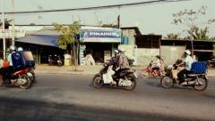Vietnamese riding scooters on the road. Vietnam Stock Footage