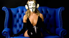 Stock Video Footage of vendetta anonymous mask activist sexy gogo costume hacker party