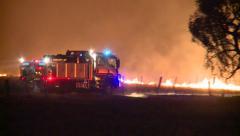 Fire Truck crossing near fire front Stock Footage