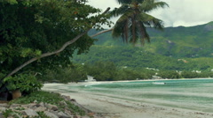 Tropical beach with palms and rocks, Mahe Island, Seychelles. Stock Footage