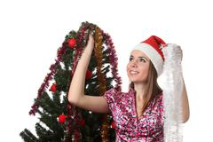 Woman decorate a christmas tree Stock Photos