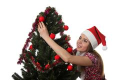 Woman decorate a christmas tree - stock photo