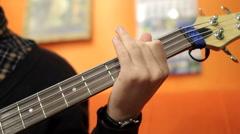 Man playing guitar in recording studio Stock Footage