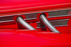 Red automobile exhaust system componen-corrugated pipe - stock photo
