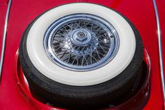 Spare tire on an red retro car - stock photo