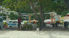 Tourists and locals at Beau Vallon Beach in the west of Mahe. Stock Footage