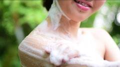 Woman take a bath outdoor Stock Footage
