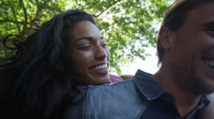 4K Attractive mixed ethnicity couple having fun in the city. - stock footage