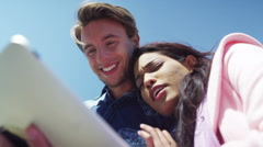 4K Attractive young couple using computer tablet outdoors  - stock footage