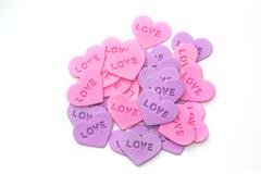 Colorful  heart-shaped sprinkles on white - stock photo