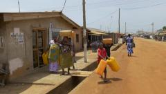 Ghana african group carry water steady 4K Stock Footage