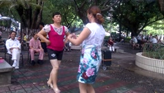 Chinese women in dancing, very happy Stock Footage