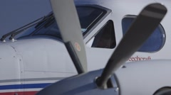 RFDS Flying Doctor aeroplane cockpit pre-flight from exterior, Kingair propellor Stock Footage