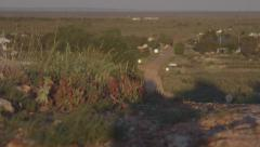 White Cliffs, NSW, Australian outback opal mining town high perspective pan left Stock Footage