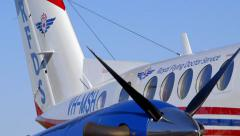 RFDS Flying Doctor plane pan right across new 2015 logo or livery Stock Footage