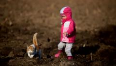 Little girl playing with a red cat in winter Stock Footage
