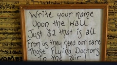Names on pub wall community fundraising for RFDS Flying Doctor charity, zoom out Stock Footage