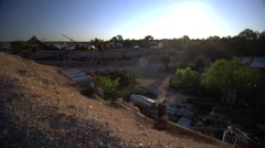 Opal mining town in outback Australia, pan right wide angle Stock Footage