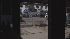 Semitrailer and campervan vehicles outside Australian outback pub Stock Footage