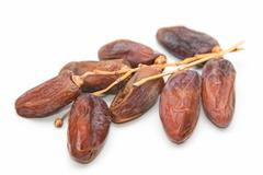 Close up of dried dates on white background Stock Photos