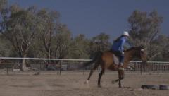 Girl trots with horse in outback NSW, Australia Stock Footage