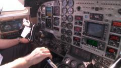 Pilot prepares cockpit controls in twin engine kingair airplane Stock Footage