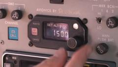 Pilot sets altitude dial in King air aeromedical aircraft controls Stock Footage