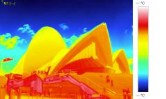 Tilt from sky to building in infrared thermographic video - thermal imaging Stock Footage