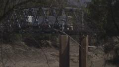 Truck crosses bridge over low water level Darling River during drought, zoom out Stock Footage