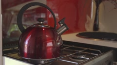 Kettle on caravan gas stove, lighting sound, starts to whistle Stock Footage